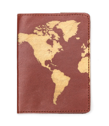 brown leather passport cover with gold world map detailing