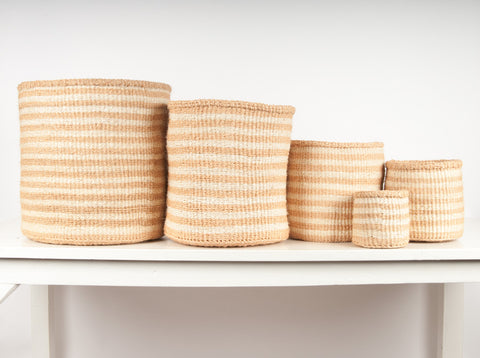 set of handwoven neutral striped African storage baskets