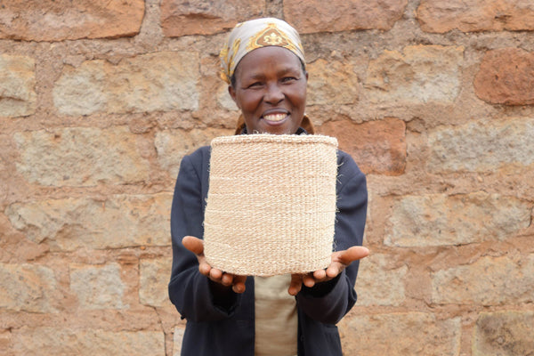 weaver with the basket she has handwoven