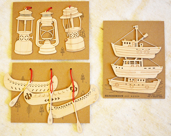 collection of handcrafted wooden Christmas Tree ornaments lanterns, boats, canoes