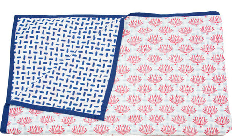 reversible baby block print blanket with lotus print and geometric reverse