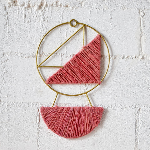 handmade brass and wool geometric wall art