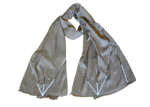 handmade tan scarf with beading detail by Maasai artisans