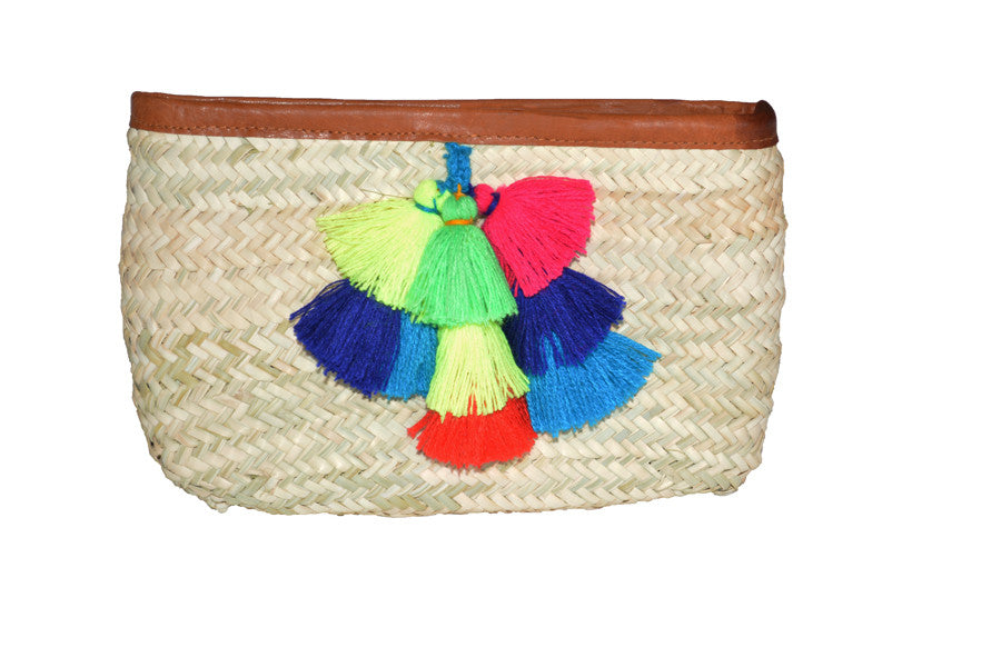 woven straw clutch with leather trim and colorful tassel accents