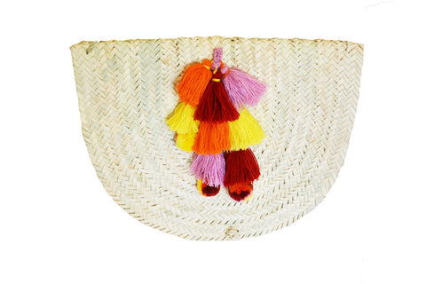 woven purse with tassel and pom-pom detail