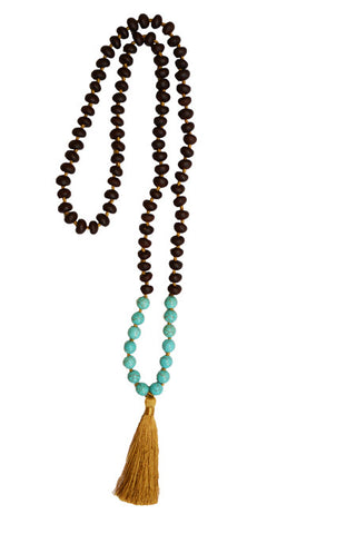 long beaded necklace with turquoise and tassel