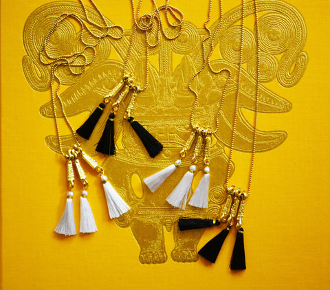 tassel fringe necklace with brass detailing and long chain