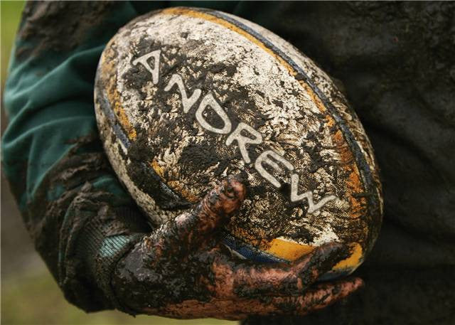 Muddy Rugby Ball Poster