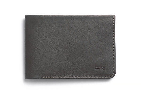 Premium vegetable tanned leather Low Down wallet from Australian designer Bellroy, offered by Whiskey Ginger. Charcoal color with brown interior. Front view of wallet.
