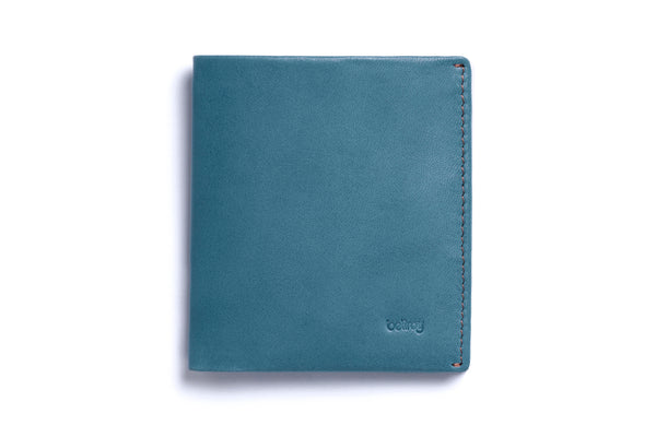 Premium vegetable tanned leather Note Sleeve wallet from Australian designer Bellroy, offered by Whiskey Ginger. Arctic Blue colored leather with contrasting interior. Front view of wallet.