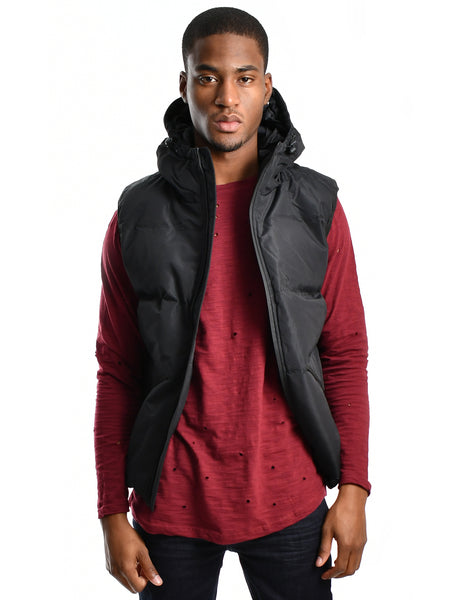 Hooded puffer vest in black titled