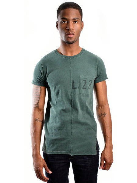 Long fit constructed T-Shirt from Dutch designer Scotch & Soda, offered by Whiskey Ginger. Amsterdam Blauw, Lot 22 edition. Hunter green fabric. Pocket and L.22 icon over left chest. Front view of T-Shirt, worn by a male model.