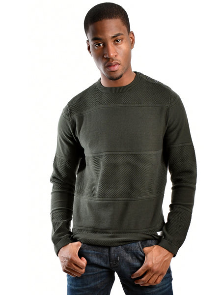 Rosin forest green crewneck sweater from Danish designer Jack & Jones, offered by Whiskey Ginger. Ribbed and honeycomb alternating knit fabric. Button closure over left shoulder. Front view of sweater worn by a male model.