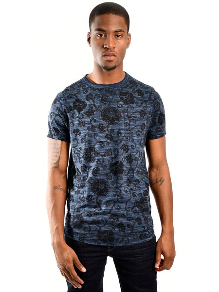 Long fit floral burn-out T-Shirt from Dutch designer Scotch & Soda, offered by Whiskey Ginger. Burn-out navy fabric with all-over floral print. Front view of T-Shirt, worn by male model.
