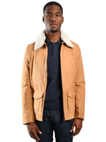 Waist length leather jacket from Dutch designer Scotch & Soda, offered by Whiskey Ginger. Teddy collared jacket, with removable collar. Zippered closure with front pockets. Front view of jacket, worn by a male model.