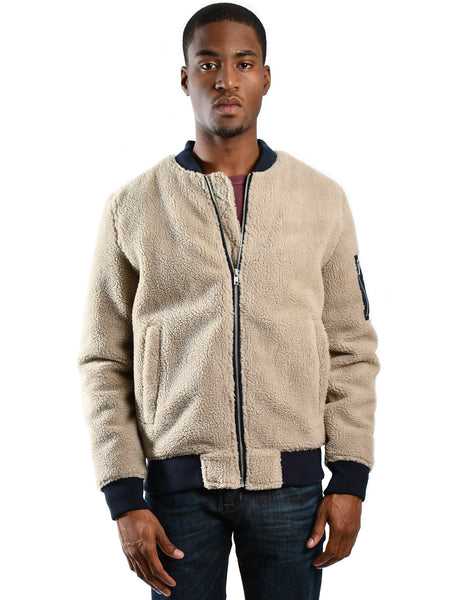 WeSC The Teddy Bomber Jacket in Chinchilla Tan. Front zip bomber with contrasting features. Front view of bomber, worn by a male model.