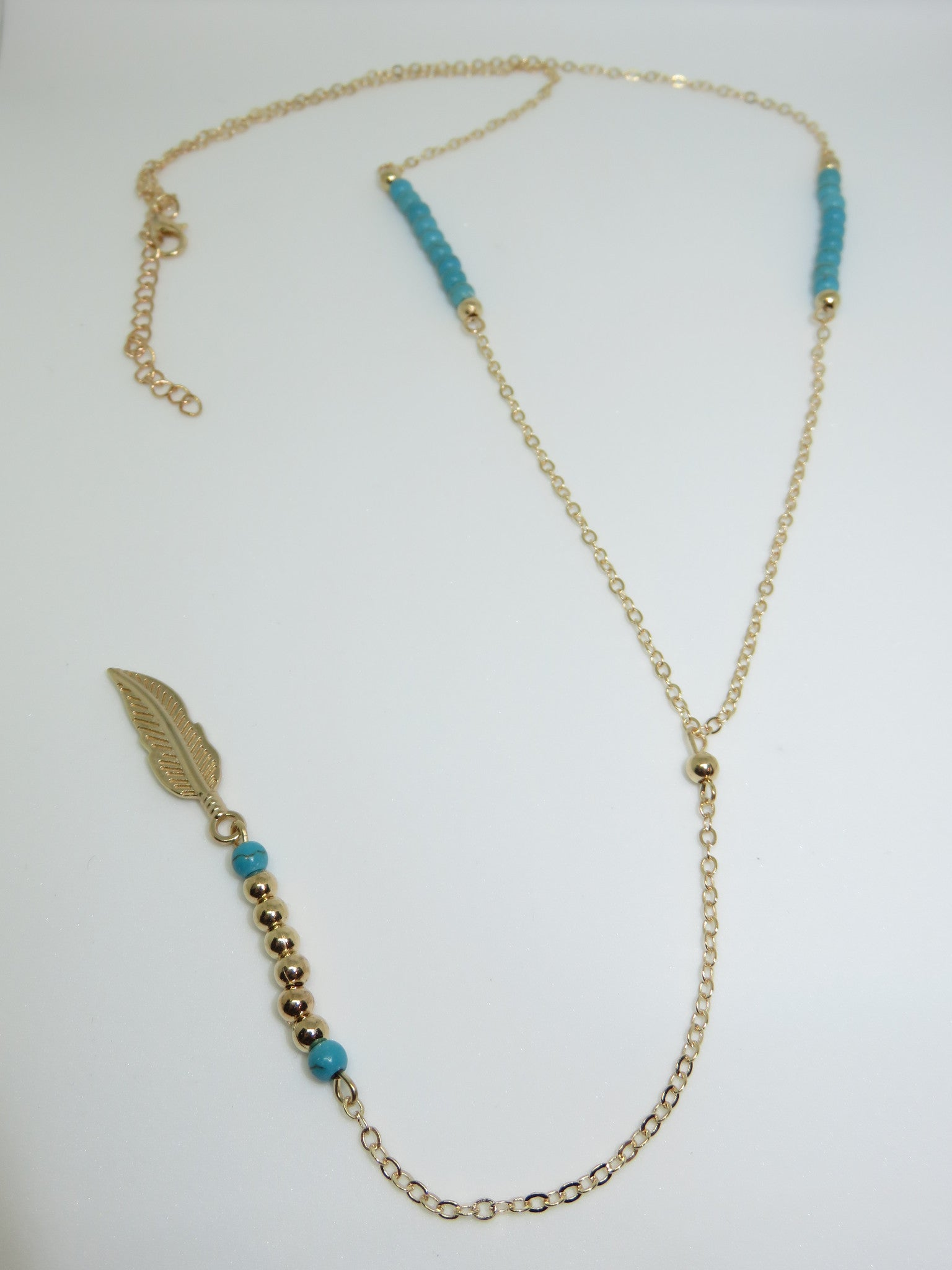 Gold Feather Necklace - Asharlah.com