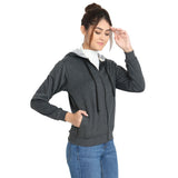 Side pose of Model wearing TeeMoods women's fleece Dark Grey hoodie in a happy mood