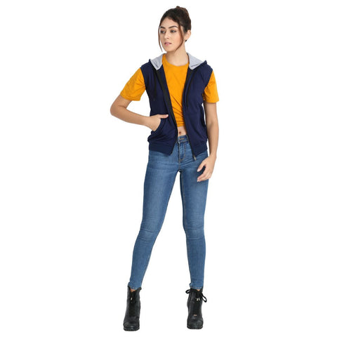 Model wearing Teemoods Women's Fleece Sleeveless Hooded Sweatshirt with half sleeves tee and jeans.