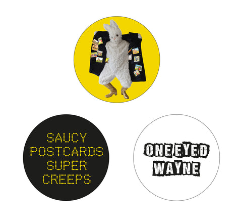 ONE EYED WAYNE - SAUCY POSTCARDS BADGE SET