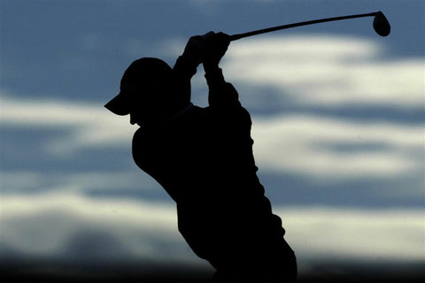 Silhouette of Justin Rose Driving