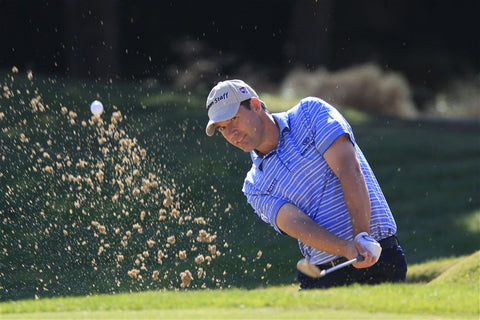 Padraig Harrington splashing out the bunker