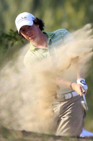 Rory Mcllroy splashing out the bunker