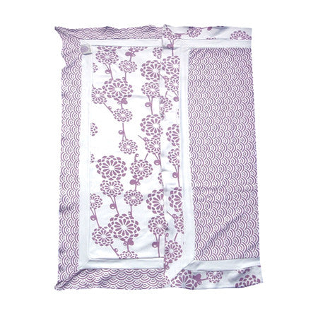 Gorgeous baby blanket in a soft lilac is a perfect for swaddling and reversible print add a beautiful design element to that special nursery.