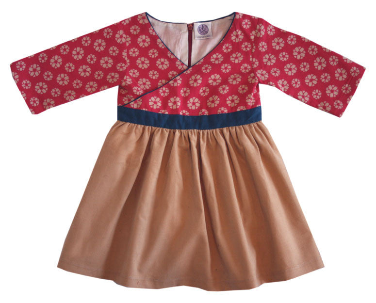 Baby dress with magenta criss-cross top and camel corduroy skirt