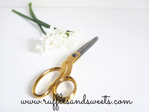 gold scissors, flowers