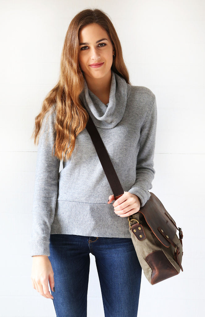 Woman wearing grey canvas leather camera bag cross body