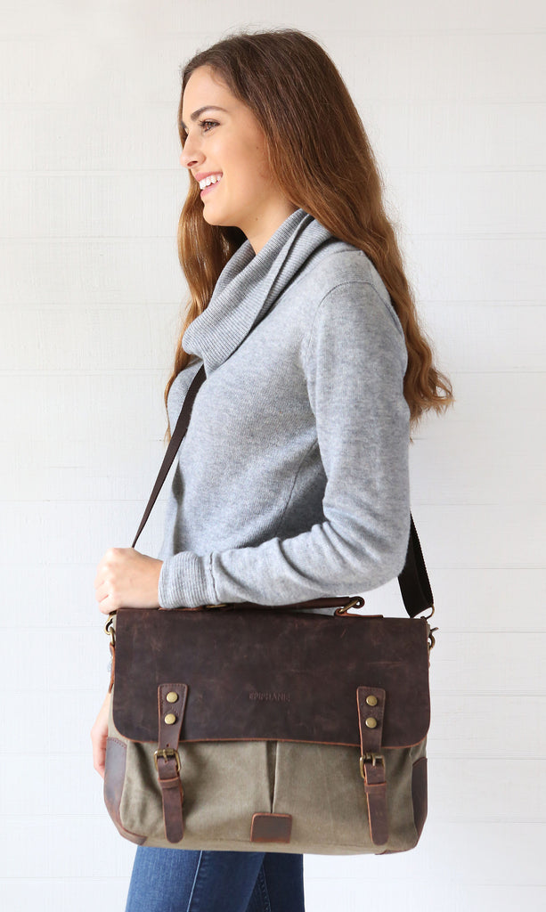 Woman wearing grey canvas leather camera bag over shoulder
