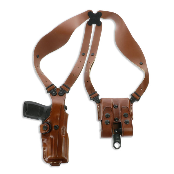 Premium Steerhide construction  Vertical handgun carry  Vertical double magazine carrier with secure flaps  Double dump pouch for revolvers  Comfortable wide harness with swiveling Flexalon backplate  Accepts optional accessory attachments  Includes tie-d