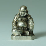 Laughing Buddha, especially popular in China, in small brass statue.