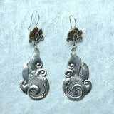 Buddhist-inspired cloud, fire and lotus sterling-silver earrings, made in Nepal.