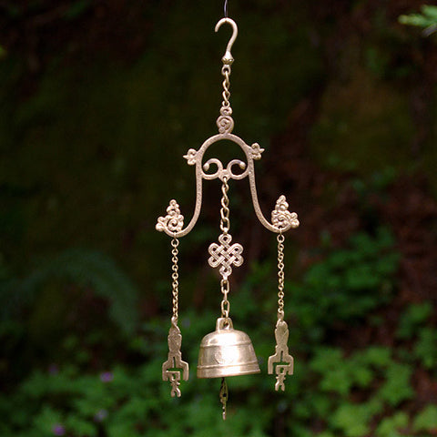 Tibetan windchime from India for creating a peaceful, meditative space in your home and garden. It is decorated with the endless knot, good-luck symbols,  key symbols and the sun and moon.