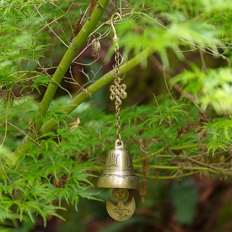 Buddhist windchime for garden. The wind releases the mantras cast in the hanging bell, the sound acting as the 'divine voice'..