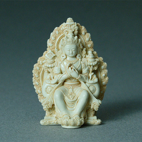 Maitraya Buddha, the coming Buddha, in resin statue, shown seated in Western style, hands in dharmachakra pose, teaching the dharma