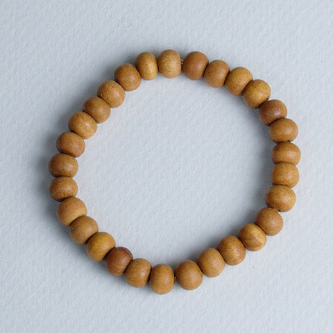 Sandalwood wrist mala for mantra meditation, useful for both Hindus and Buddhists.
