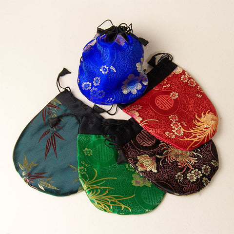 Drawstring bags for jewelry, malas, smaller gifts. Made in Kathmandu, Nepal, by a women's fair trade cooperative.