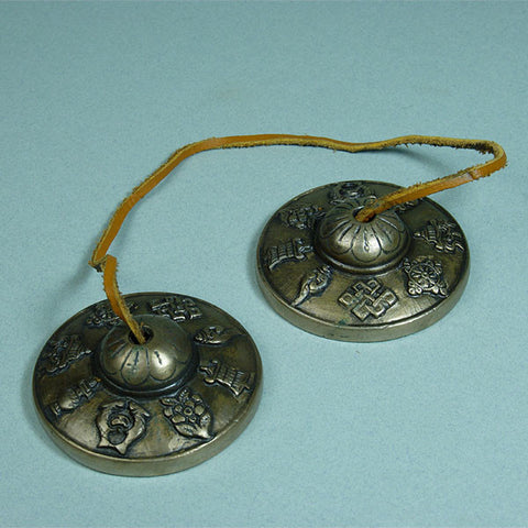 Tingsha for meditation from the Tibetan Buddhist tradition, embossed with eight auspicious symbols.