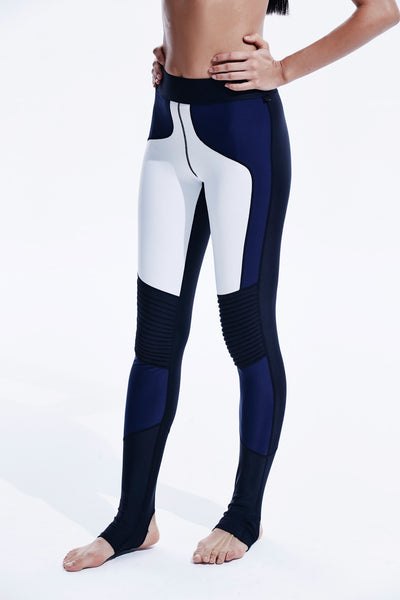 Stellar Leggings with pleated detail at knee, mid-rise waist with stirrup features. Comes in white/navy/black combo color.