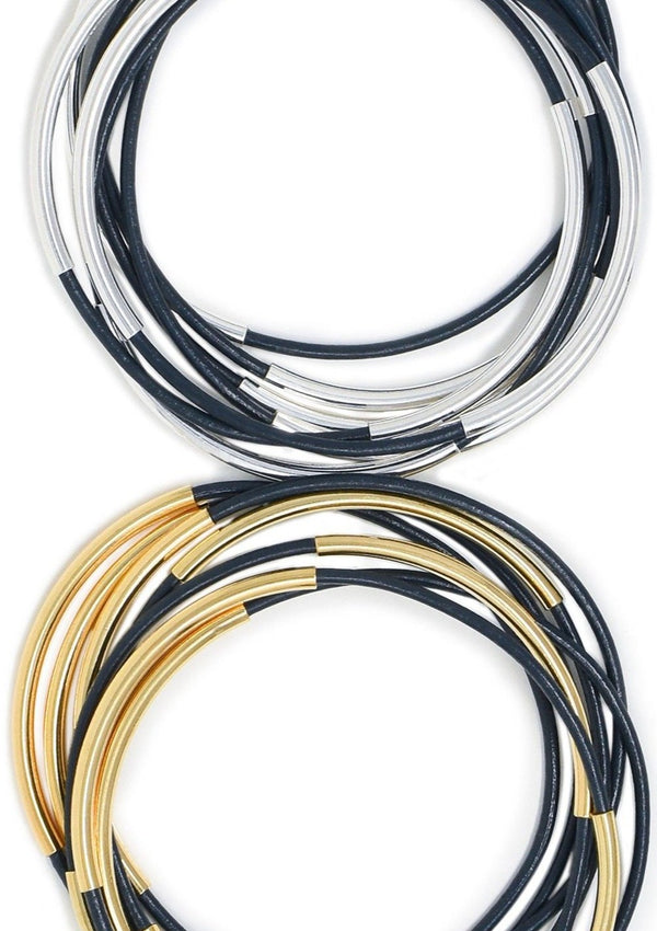 Navy leather bracelets shown with silver and gold beads.