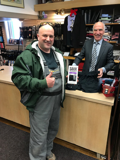 Mr. Luke Tower purchasing a pair of Saxx underwear from store owner, Robert Mansour.
