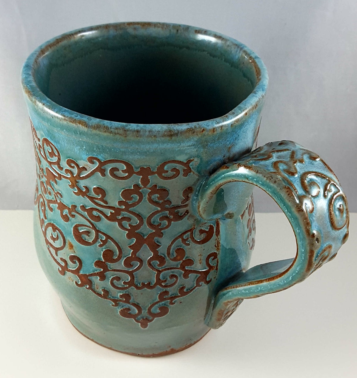 Turquoise Mug with Brown Lace