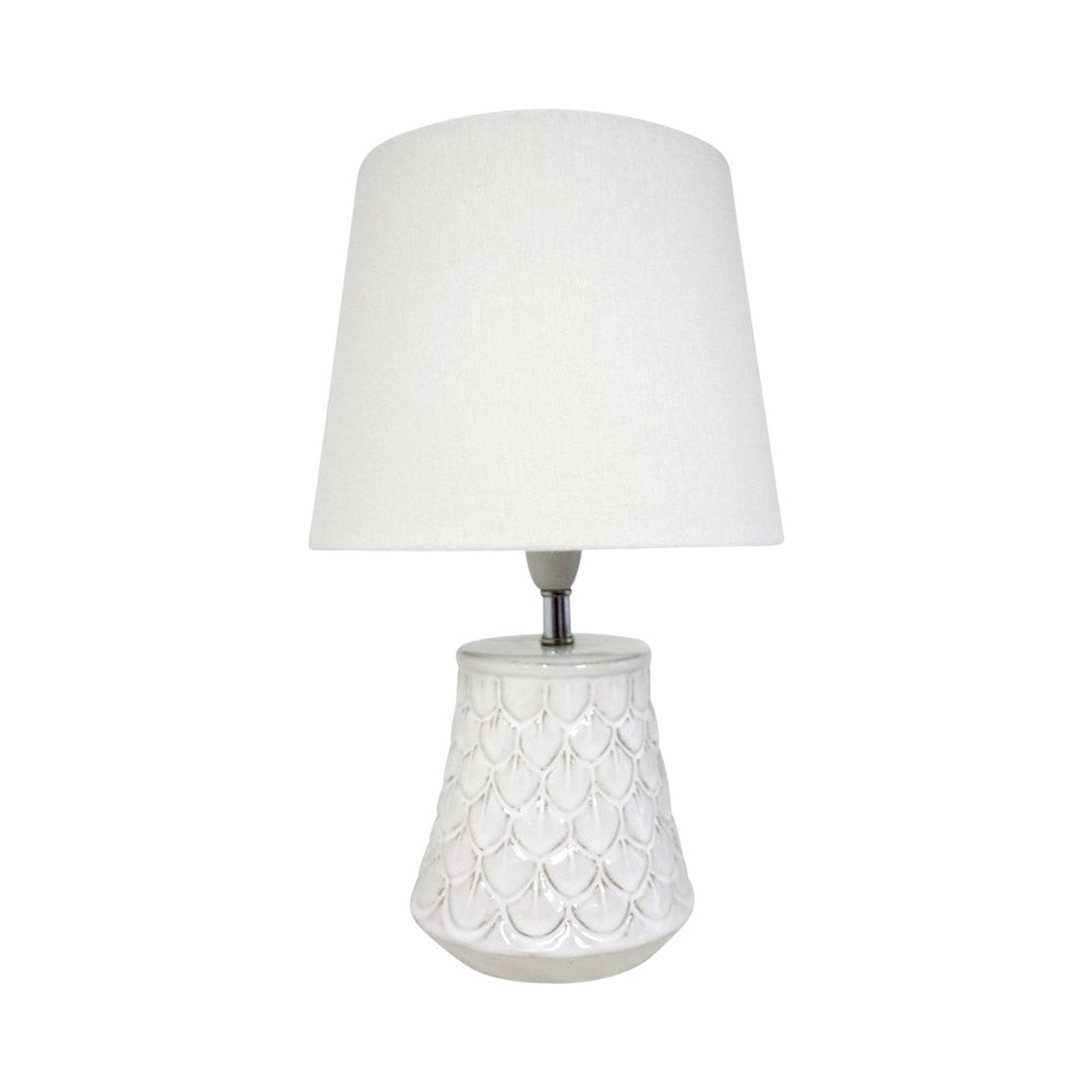 Small white table lamp with linen shade.