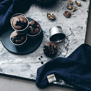 dark blue napkins with some freshly baked muffins