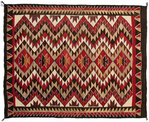 The Red Mesa rug style is considered a form of Teec Nos Pos, but also maintains the rather poignant eyedazzler effects due to the contrasting light and dark colors, vertical chevrons and radiating diamonds.