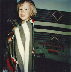 Little Chief Sean models one of the Navajo Chief Blankets