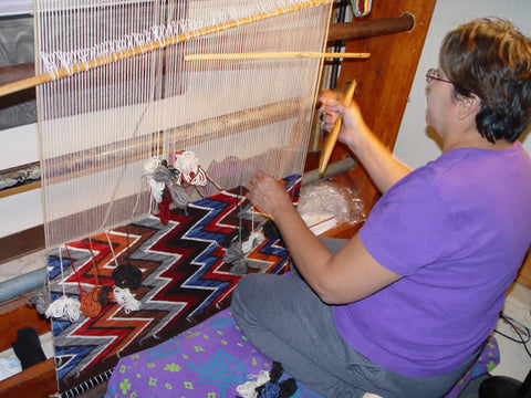 Frances Begay weaving an Eye Dazzler Navajo rug